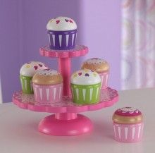 Our Cupcake Stand with Cupcakes is a perfect kitchen accessory for any of the young chefs in your life! Kids will love putting the cupcakes on display for the whole world to see. Maybe they'll even sell you one!  Features: Two-tier cupcake stand 6 pretend cupcakes – mix and match the tops and bottoms to make your own colour combinations Smart, sturdy construction Made of composite wood products  This products is a special order item and delivery is approx 5-10 days