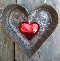 Simple decoration for Valentine's day...red glass heart ornament inside vintage heart pan