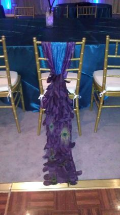Peacock Chair Cover/ Peacock Sash for Chivari Chairs. Beautiful Teal/Turquoise with Purple and Peacock feathers Chair Cover/Sash.. $12.00, via Etsy.