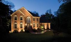 Architectural lighting on brick home wash the facade with light