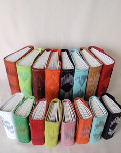 Various Leather books made with an Altered Longstitch Binding, created by Jennifer Wolken, www.theartiststudioonline.com