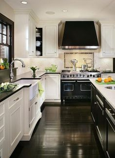 elegant black & off white kitchen with dark hardwood floor