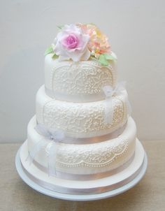 White lace and sugar flower wedding cake