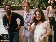 John and Yoko, with friend Miles Davis.  Look at the expression on the guy's face behind them...