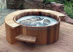 Woodstove fired hot tub... i need this.
