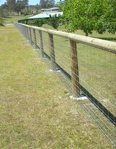 round posts flush rail and fence  kopperslog dog wire.jpg (595×767)