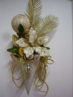 Gold and Ivory Holiday Floral Arrangement in Metal Wall Cone. $35.00, via Etsy. A beautiful ivory metal cone with embossed leaf design is filled with elegant holiday floral. Loops of gold braid enhance either side adding to the opulence. I've tucked gorgeous gold and silver acrylic ornaments here and there to give this a full and luxurious presentation. There is a twisted wire handle on the back for hanging.