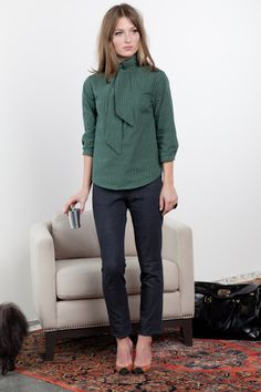 Green blouse w/slim black pant.  Love the shoes, too.