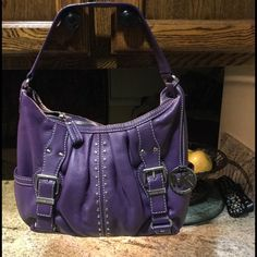 AUTHENTIC MK SILVER HARDWARE PURPLE LEATHER! NWOT AUTHENTIC MK SILVER HARDWARE PURPLE LEATHER! bag is perfect, no flaws whatsoever. Michael Kors Bags