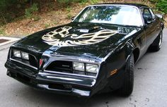 This 1977 Trans Am is the same year and color of the one I owned when I was in High School and College. Unfortunately a truck driver ran a red light and took it out.