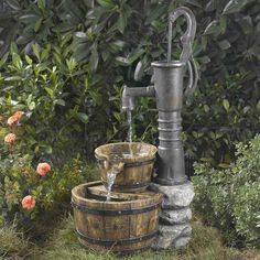 This Outdoor Water Pump Half Whiskey Barrel Style Water Fountain brings the unmistakable look of the Wild West into your home or garden. A classic water pump is perched on a stone wall-inspired pillar. The pump trickles a stream of water Garden Water Fountains, Water Garden, Outdoor Fountains, Fountain Garden, Barrel Fountain, Fountain Ideas, Fountain Design, Pool Fountain, Herb Garden