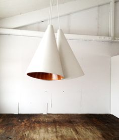 wood floors, white walls with a statement lamp that blends in