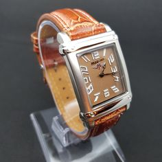 Men's wristwatch in vintage retro look rectangular with leather strap for Oktoberfest or folk festival in Bavaria, Tyrol - Ischgl, Austria #Women39;sWristwatch #GirlsWatches #Women39;sWatches #Pm #VintageWristwatch #VintageWatches #VintageWatch #Vintage #GirlClock #Women39;sWatch Traditional Jacket, Retro Look, Adjustable Bracelet, Leather Material, Stainless Steel Bracelet, Vintage Watches, Retro Vintage, Brown Leather, Etsy