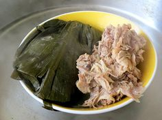 Pork lau lau is Hawaiian soul food at its finest: Fatty pork wrapped in taro leaves, then pressure cooked in a steamer oven until it's melt-in-your-mouth tender. Traditionally, lau lau is cooked in an underground imu oven for many hours, often accompanied by salted butterfish and sweet potato. Though the pork is served inside the taro leaves, the leaves are not to be eaten—their only purpose is to seal in flavor and moisture, to create intensely juicy, succulent pork.