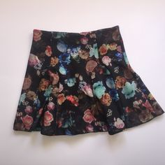 Mossimo floral printed skirt  Super cute floral printed skirt. Flares out. Stretchy. Thick material. 92% polyester. 6%. spandex. Zipper up the back of skirt with clasp at the end. Would look cute with a causal tee. Dress up with heels or dress down with boots. Mossimo Supply Co. Skirts