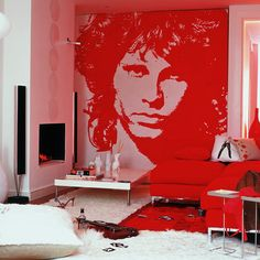 Fantastic idea it would be a problem deciding who to paint on the wall. Anyway love the feel of this room