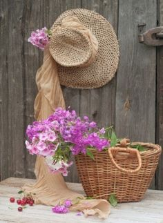 Photo about Rustic image of a gardener s straw hat and basket. Image of flowers, abstract, closeup - 21183605 Still Life Photos, Love Hat, Flower Images, Flower Basket, Geraniums, Watercolor Flowers, Beautiful Flowers, Beautiful Beds, Rustic
