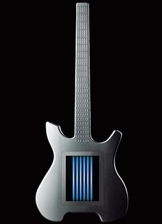 The Kitara is a keytar for the iPhone generation: combining a multi-touch touchscreen, a fretboard and a fully fledged synthesizer, it enables you to assign 100 different sounds to its virtual 'strings'.   Read more at : www.dailymail.co....