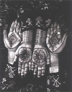 Henna decoration on the hands of Palika and Debrae