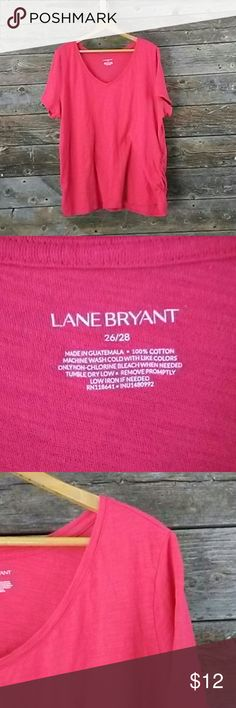 Lane Bryant 26/28 short sleeve V-neck shirt Lane Bryant 26/28 short sleeve V-neck shirt. Bottom of shirt sides has lightly scrunched material as shown in picture. Shirt color is brighter...the lighting is making the color look more pink then red. Lane Bryant Tops