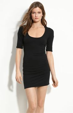 Cotton black dress. Versatile. Sweater over it during the day and then throw the sweater in your bag for night.