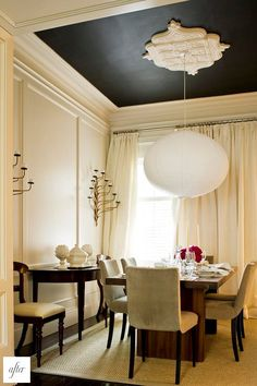 A Noguchi Akari lantern and a pitch-dark ceiling add a modern note to this dining room by the McGill Design Group. Different fixture for sure but love the drama of the black ceiling and medallion Dark Ceiling, Colored Ceiling, Ceiling Color, Accent Ceiling, Ceiling Rose, Ceiling Trim, Modern Ceiling, Molding Ceiling, Trey Ceiling