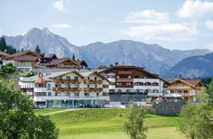 High up in the mountains, dive into your dreams! Right in the center of the Olympic region Seefeld. A 5-minute walk from the Gschwandtkopf Ski Area and Seefeld's pedestrian zone, the St. Peter Hotel & Chalets de luxe offers spacious rooms, a large spa area with an indoor pool, free WiFi, and free parking. Cross-country ski runs are right outside. Hotels, Cross Country Skiing, Outdoor Pool, Hotel Offers, Golf Courses, Indoor, Storage Room, Mansions, House Styles