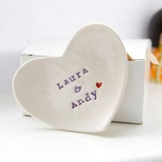 Cute wedding gift idea : )  Personalised wedding ring dish custom porcelain heart wedding ring bearer bowl. £19.00, via Etsy.
