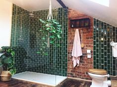 We love everything about this utterly stunning bathroom by @two_bears_at_no.96! The green tiles mixed with the exposed brickwork really is beautiful and gives the bathroom a luxury holiday feel to it.  #loverenovate #shower #bathroominspiration #greenery #bathroomjungle #luxurybathroom #renovate #renovatedhome #renovationlife #renovationproject #homeextention #beforeandafter #renovation #renovatingyourhome