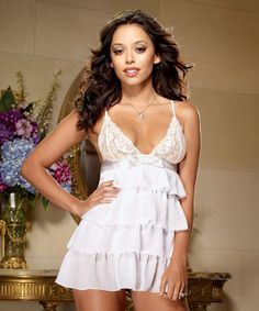 Sugar  In this exquisite white lingerie, you're sweet as Sugar! The scalloped stretch lace cups are just the icing on the cake—a chiffon skirt tiered like a layer cake and designed to enhance every curve. The entire treat is garnished with a bow and ribbon detail. This sexy white lingerie includes matching thong.  $59.00  portiasnyder.pureromance.com