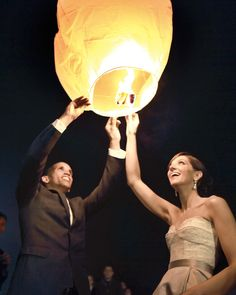 "As the evening came to an end, friends and family headed outdoors to say good night to the happy couple. ""Jamie's mom loved the wish lanterns in the film ""Tangled"" and suggested we use them,"" says Steve. ""At the end of the night, each couple lit one, and we set them free before driving away."""