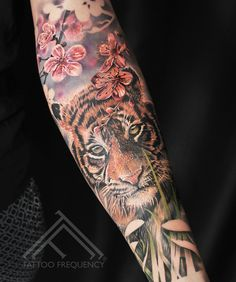 Freshly done, realistic tiger with cherry blossoms on womans arm Dope Tattoos, Trendy Tattoos, Body Art Tattoos, Realistic Tattoo Sleeve, Tiger Tattoo Sleeve, Arm Tattoo, White Tiger Tattoo, Natur Tattoo Arm, Natur Tattoos