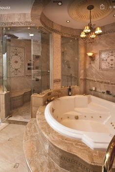 Traditional Master Bathroom with High ceiling, Wall sconce, Master bathroom, Handheld showerhead, Pendant light