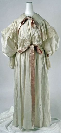 1894 Victorian sleepwear, elegant nightgown with lace and bows.