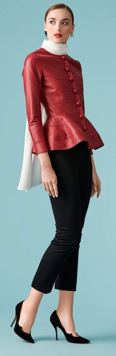 Doña Letizia wore a deep red Carolina Herrera peplum jacket (US$2,990). The leather jacket is defined by a peplum hem and features a round collarless neckline, horizontal seams, and leather covered buttons down the front and cuffs. Queen Letizia of Spain attend the Join 'Coworking santander' Programme on June 23, 2017 in Santander, Spain.