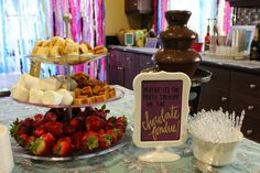 Frozen Inspired birthday party.  Frozen quotes/signs by Outside The Bloom and Daisy Dreaming.  Chocolate Fondue station.