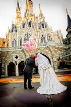 Bride and groom in Magic Kingdom with pink Mickey balloons - Disney Castaway Cay Wedding: Lisa + Rob   Magical Day Weddings   A Wedding Atlas Fan Site for Disney Weddings