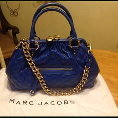 Beautiful blue Marc Jacobs large authentic stam This bag is in great pre-owned condition. One small mark inside, some light scratches to the hardware, very light wear to the leather. Comes with dust bag. Feel free to request more pics. The first picture is the most accurate color. It's a deep, vibrant blue. Please note: this is a very large, heavy bag. It's well made, and the chain makes it heavy. It fits a ton of items. Leather with canvas interior.  Marc Jacobs Bags Shoulder Bags