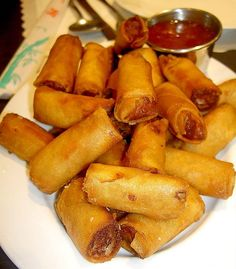 Lumpiang Shanghai / Shanghai Roll is meat laden filled with ground pork or chicken, minced onion, carrots and spices with the mixture held together by beaten egg. It may sometimes contain green peas, cilantro or raisins. Served with sweet and sour sauce for dipping.