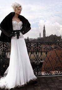 El toque principal en negro lo da la estola y el lazo alrededor de la cintura | Black and White Wedding - Atelier Aimee #vestido #novia