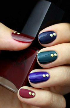 simple nail designs In dark blue with gold stripes
