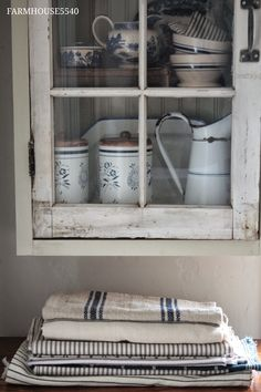blue and white towels and ticking, and a whole cupboard full of good stuff!