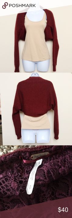 Free People Maroon Sweater Shrug with Lace Lining Lovely and unique maroon sweater shrug from Free People.  Size small in good used condition.  This piece features lace lining (see pictures!) Free People Sweaters Shrugs & Ponchos