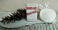 Check out this item in my Etsy shop https://www.etsy.com/listing/385980398/mid-century-band-aid-collectible-tin