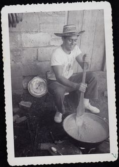Antique Vintage Photograph Man in Big Straw Hat Stirring Cement in In Huge Pan