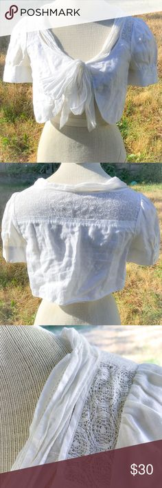 """1930s Style Embroidered White Linen Bolero Blouse I bought this a couple of years ago online as a 1930s piece, but when it arrived I found remnants of a tag cut out from a side seam. The seller insisted that it was true 30s but I'm inclined to think it's a good repro. It's in excellent condition with no issues.  Bust: 17"""" (with ties done) Shoulder: 12"""" Sleeve: 8.5"""" Cuff opening: 5.5""""  Length: 12.5"""" Vintage Tops"""