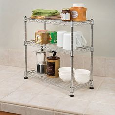 Seville Classics Mini 3-Tier Shelf Organizer  This definitely is a size that will fit the gun cabinet.  Stacking?