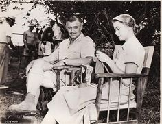 Clark Gable is so impressed by Grace Kelly knitting.