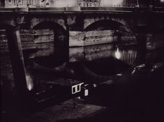 """Brassai (Gyula Halasz) Tugboats and barges beside Pont-Neuf From """"Paris by Night"""" 1933"""