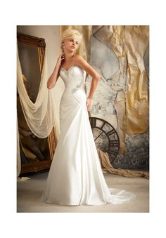 Wedding Dresses and Wedding Gowns by Morilee featuring 1919 Soft Satin Embellished with Swarovski Crystals Soft Satin drapes asymmetrically to create a figure flattering slim A line wedding dress. Swarovski crystals adorn the sweetheart neckinline and accent the corset back. Colors Available: White/Silver, Ivory/Silver. Sizes Available: 2-28.